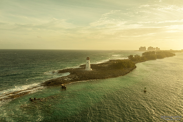 Sunrise with Lighthouse with Atlantis resort in the background - Nassau, Bahamas